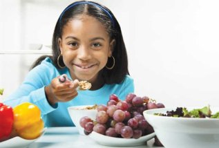 Black-Girl-Munching-on-Purple-Grapes-photo_t750x550